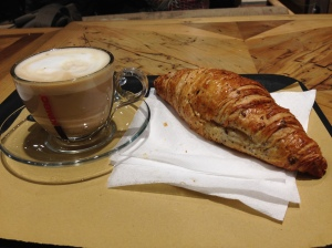 Colazione before boarding the train: a delicious cappuccino and pasticcera.