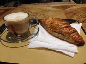 Colazione before boarding the train: a delicious cappuccino and pasticcera.