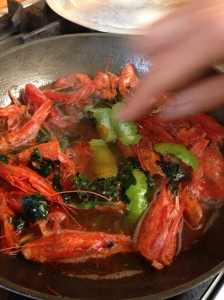 Making a sauce with the shells of the gamberi rosso (red shrimp).