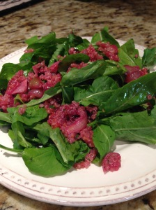 Arugula salad with quinoa, Italian prune plum, shallot, orange and juniper berry