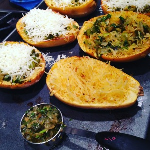 Topping the baked spaghetti squash with cooked tomatillo salsa.
